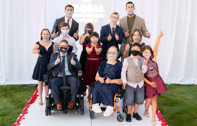 group of people in Masks on a catwalk